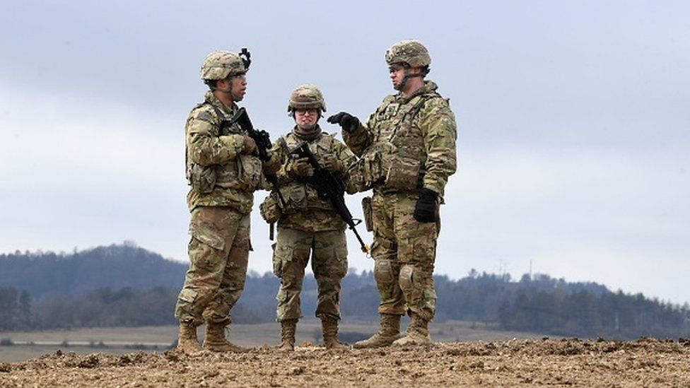 US soldiers stand together prior to an artillery live fire event at the military training area in Grafenwoehr