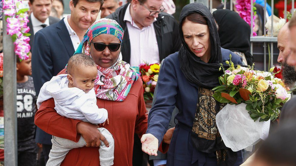 Prime Minister Jacinda Ardern visits mourners at the Kilbirnie Mosque in New Zealand