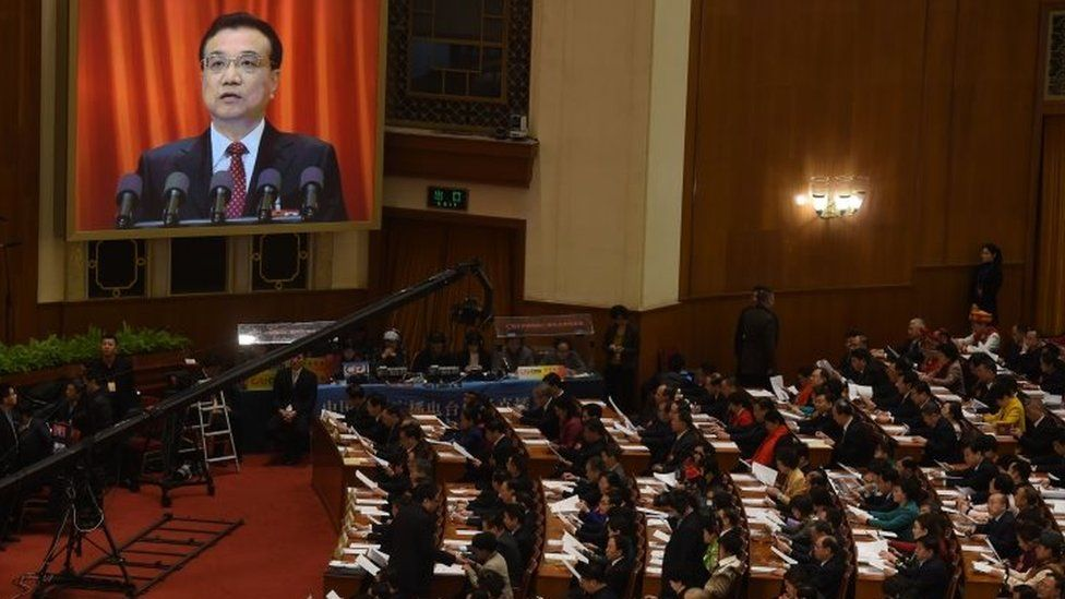 Chinese Premier Li Keqiang is shown on a giant screen as he delivers his speech at the National People's Congress. Photo: 5 March 2016