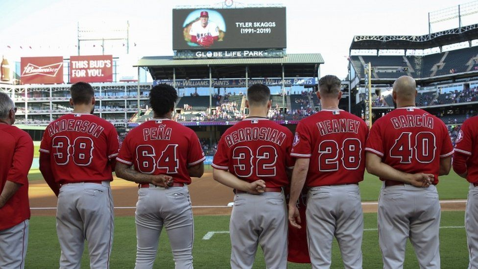 Los Angeles Angels players honour the memory of pitcher Tyler Skaggs before a game against the Texas Rangers