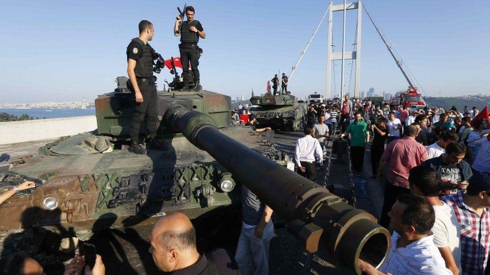 Policemen standings on a military vehicle on the Bosphorus Bridge in Instanbul, Turkey