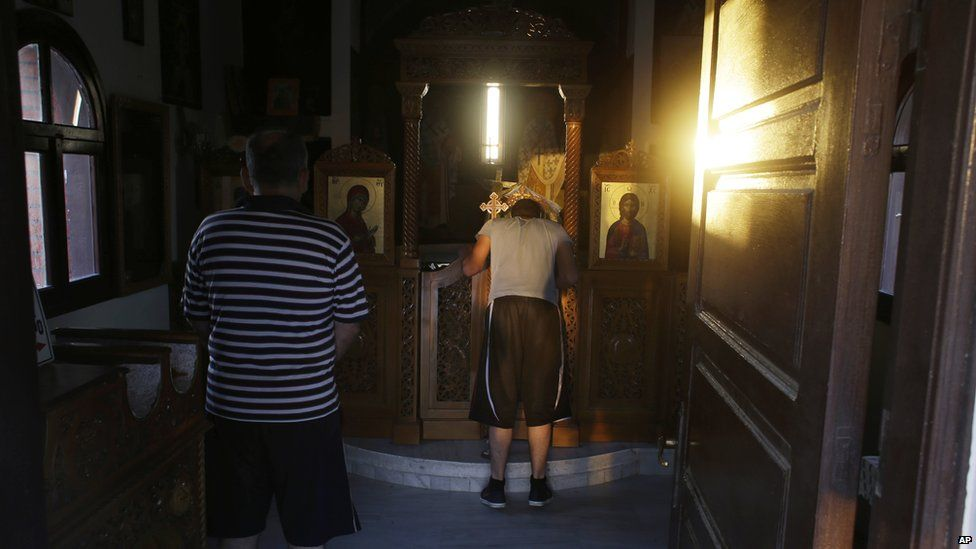 Syrian Christians in a small Greek Orthodox church on the Greek island of Lesbos on Wednesday, 17 June 2015