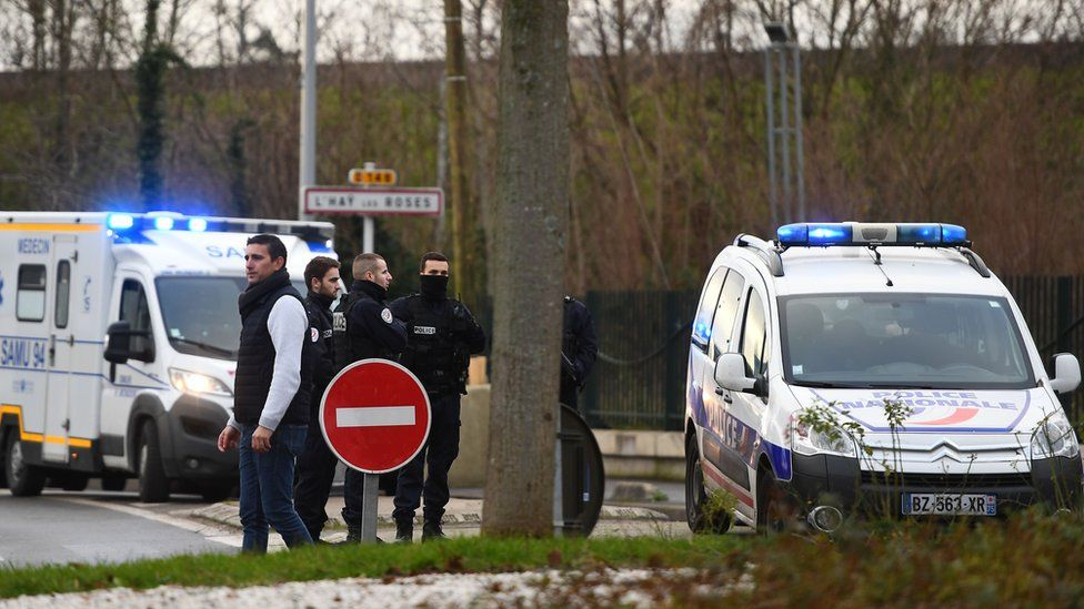 """Police stand near a park in the south of Paris"""" suburban city of Villejuif"""
