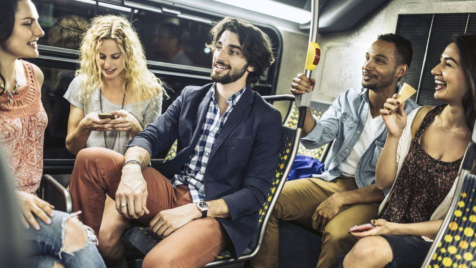 Young friends on a night bus