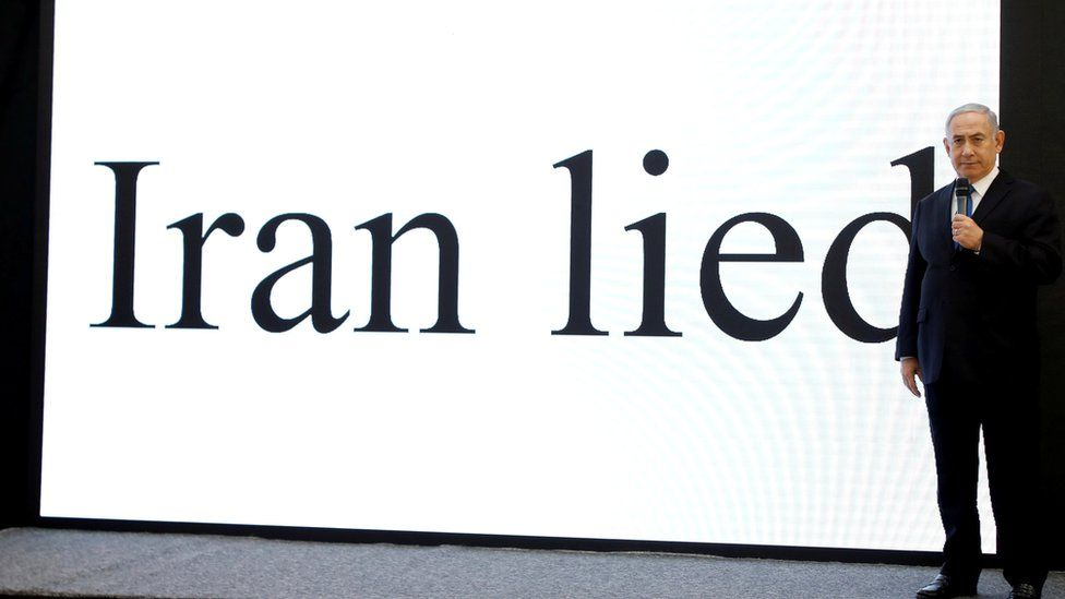 """PM Netanyahu in front of a screen bearing the words, """"Iran lied"""""""