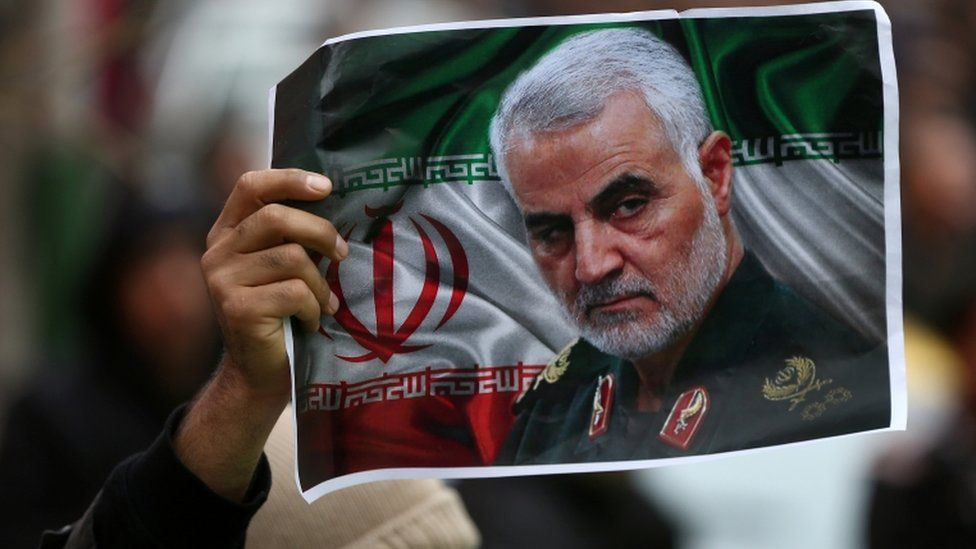 An Iranian holds a picture of late General Qasem Soleimani. 4 Jan 2020
