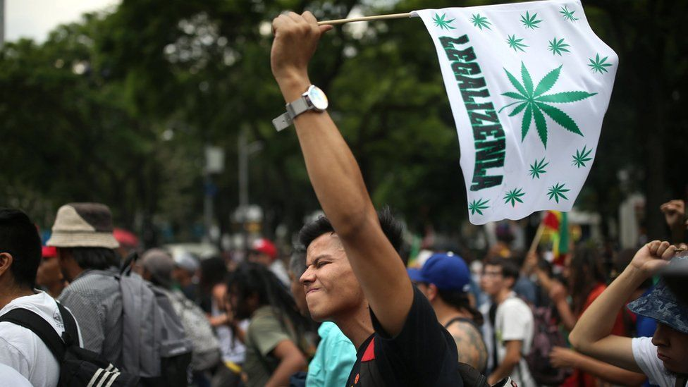 A marijuana legalization activist gestures as he participates in a protest in Mexico City