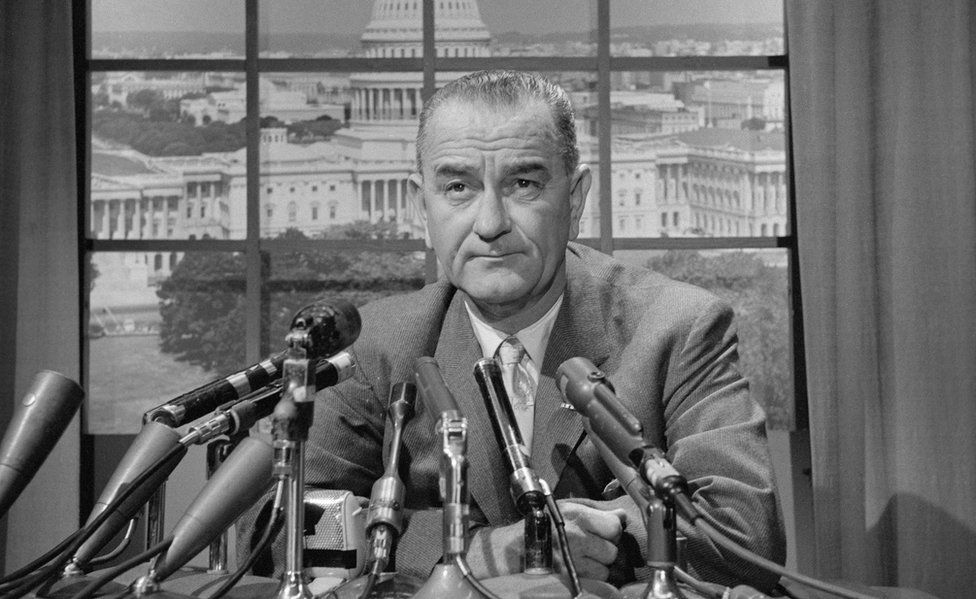 A black and white picture of Lyndon B. Johnson at a press conference