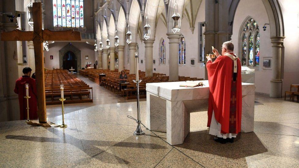 Catholic Archbishop Mark Coleridge at Good Friday Mass in empty St Stephen's Cathedral, Brisbane, Australia - 10 April