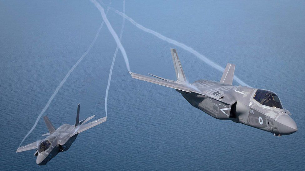 The first of Britain's new supersonic 'stealth' strike fighters accompanied by a United States Marine Corps F-35B aircraft, flies over the North Sea