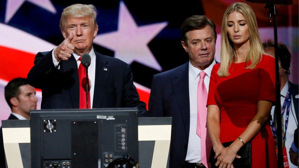 Republican presidential nominee Donald Trump gives a thumbs up as his campaign manager Paul Manafort (C) and daughter Ivanka (R) look on at the Republican National Convention in Cleveland, Ohio, in July 2016