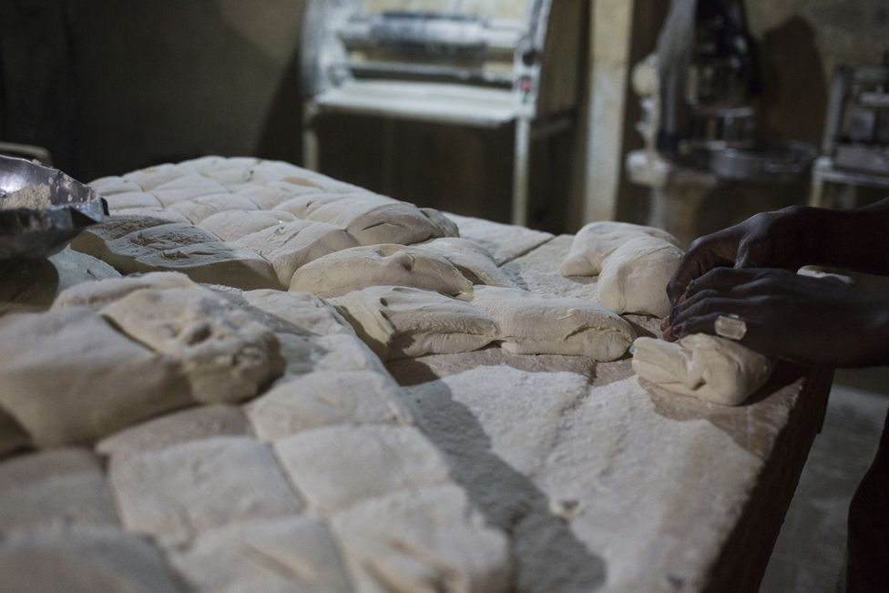Dough is separated into pieces that will eventually become individual loaves of bread at Buru Niouman Bakery in Bamako, Mali. 5 February 2019.