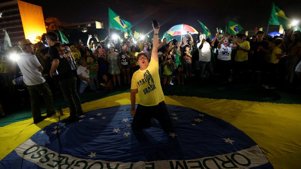 Supporters of Jair Bolsonaro, far-right lawmaker and presidential candidate of the Social Liberal Party (PSL), react after Bolsonaro wins the presidential race, in Brasilia, Brazil October 28, 2018