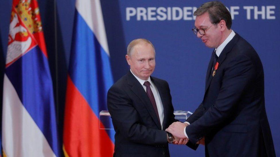 Russian President Vladimir Putin decorates Serbian President Alexandar Vucic with an order of Alexander Nevsky after their meeting in Belgrade in January