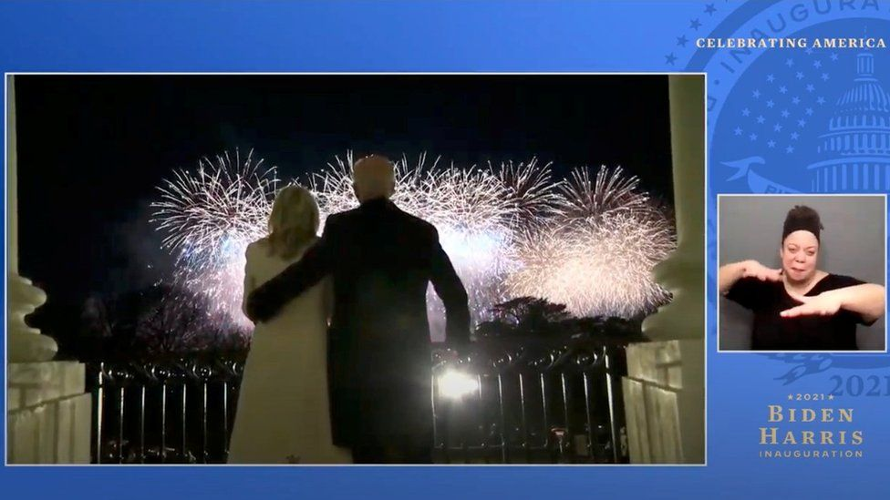 """President Joe Biden and first lady Jill Biden watch fireworks from the balcony of the White House, at the """"Celebrating America"""" event in this still image from video"""