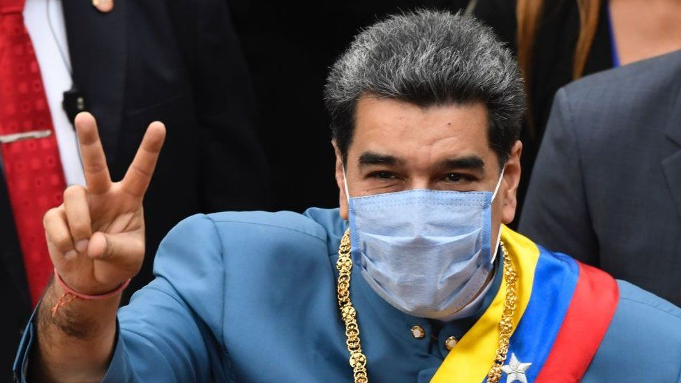 Venezuelan President Nicolas Maduro flashes the V sign as he arrives at the Congress to present the annual report of his government before the National Assembly in Caracas on January 12, 2021