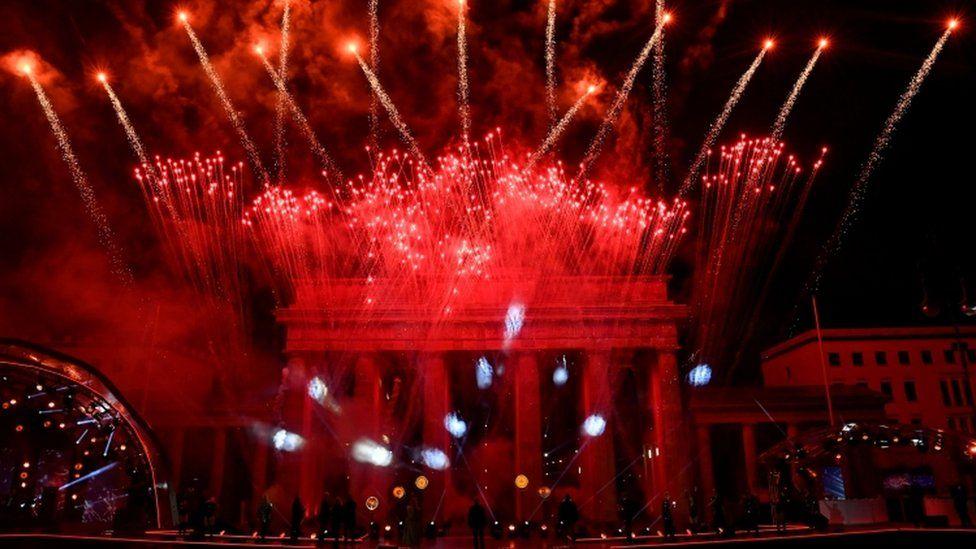 Fireworks explode over Berlin's landmark Brandenburg Gate to usher in the new year