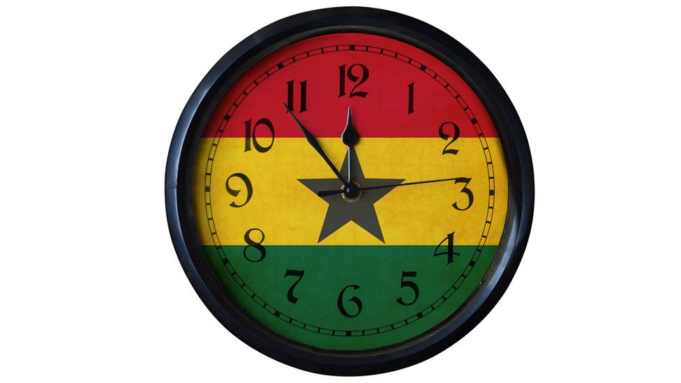 A clock in the colours of the Ghanaian flag