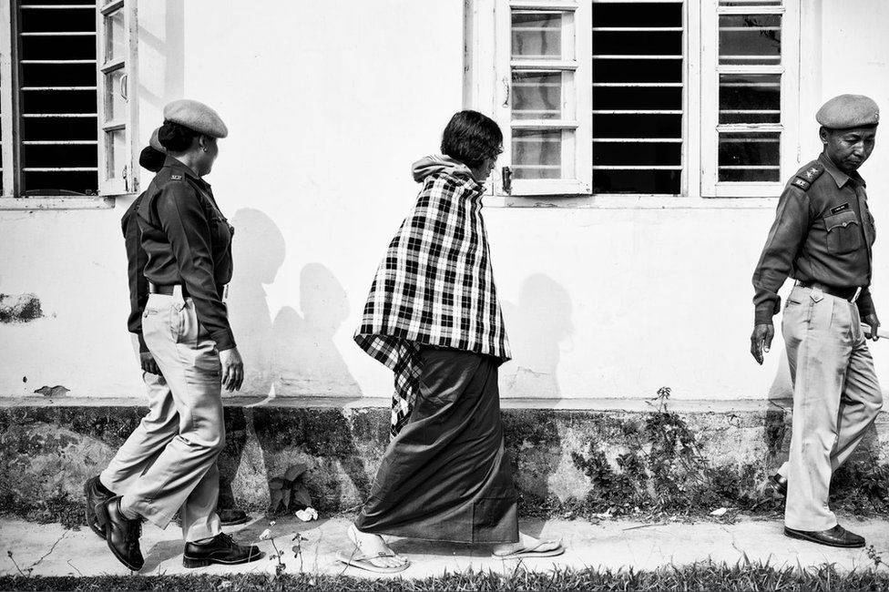 In this picture taken on 19 December 2013, she is guided into the Manipur High Court in Imphal by police guards.