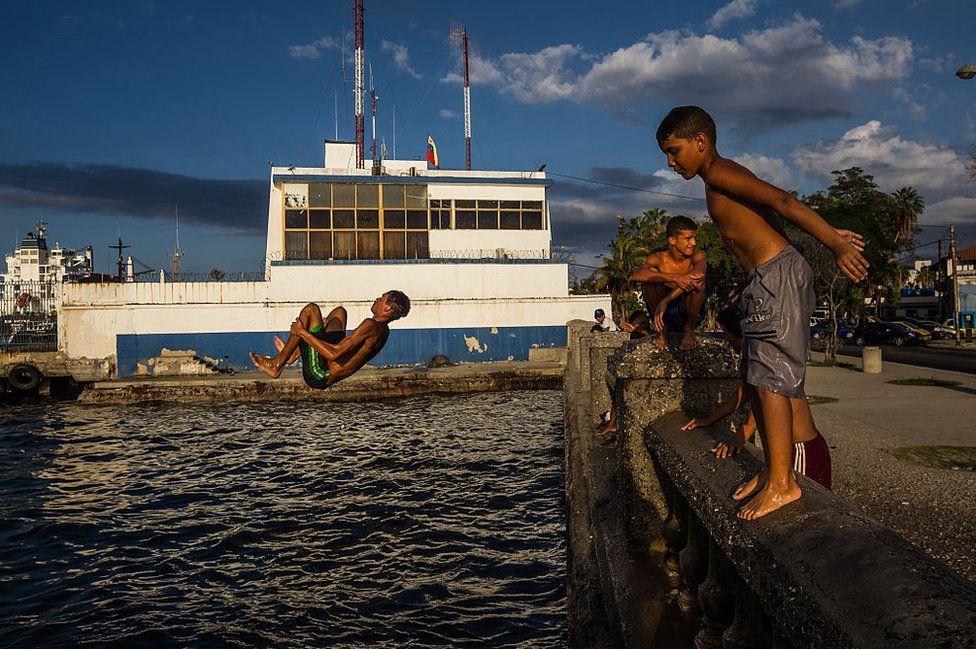 Boys jump into the sea