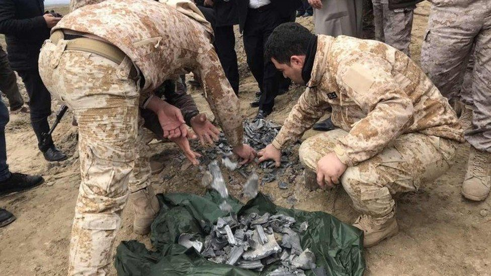 Iraqi security forces gather pieces of Iranian missile in Irbil