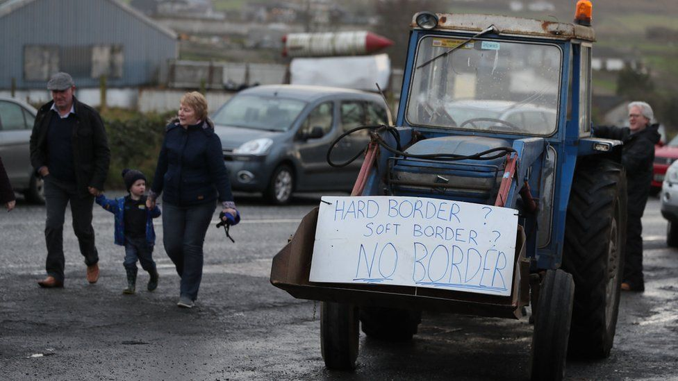 A tractor carrying a sign that reads: Hard Border? Soft border? No border!