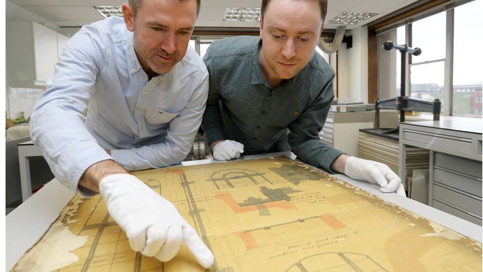 Dr Seamas Lawless (left) pointing at floor plan of 1922 Public Record Office Ireland, and (right) Dr Peter Crooks