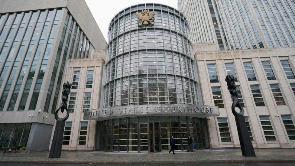 People walk past the Federal Courthouse in Brooklyn where the Fifa trial is talking place on November 13, 2017 in New York