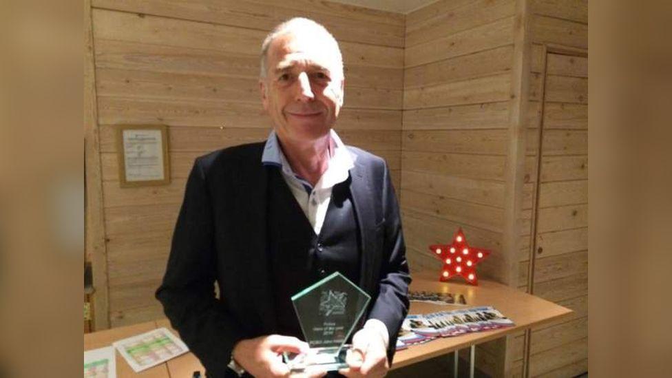 John Hood with award