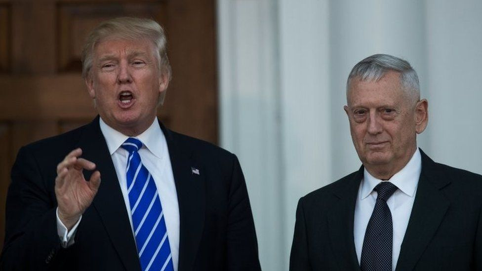 President-elect Donald Trump speaks as he stands with retired United States Marine Corps general James Mattis after their meeting at Trump International Golf Club.
