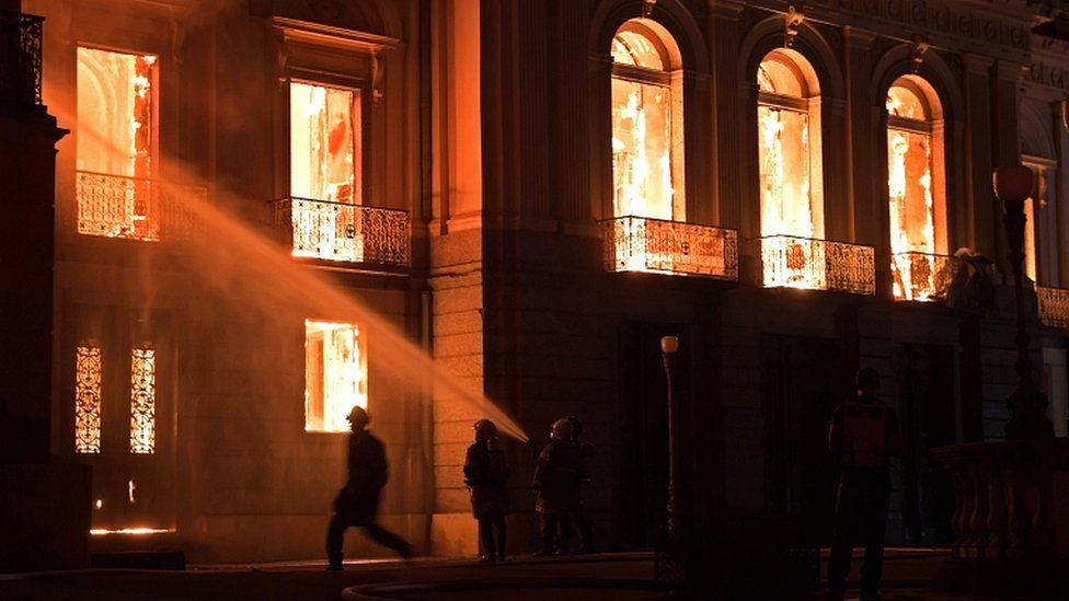 Firefighters work as a massive fire engulfs the National Museum in Rio de Janeiro on 2 September 2018