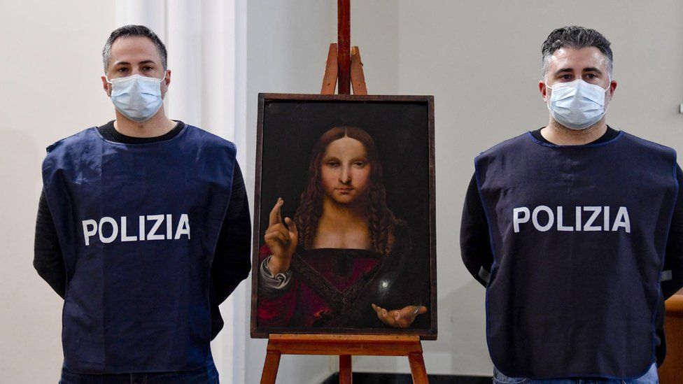 Image shows two police officers stood next to the recovered painting
