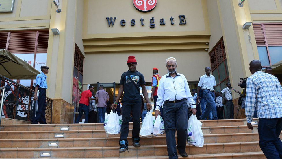 Customers leave the Westgate shopping mall after it reopened on July 18, 2015 in Nairobi. Kenya's Westgate shopping mall reopened for business on July 18, 2015