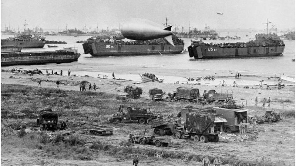 Omaha beach after the initial landings, showing naval vessels massed offshore