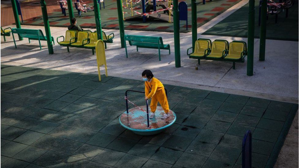 A primary school student plays in a public park in Hong Kong