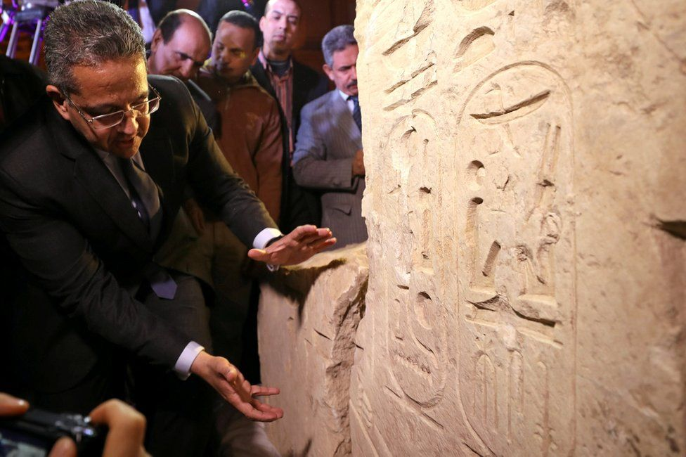 Egyptian Minister of Antiquities Khaled Al-Anani stands beside the colossus explaining new evidence pointing to it depicting Psamtek I in Cairo
