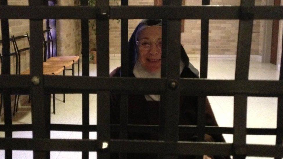 Sister Mary Joseph behind metal bars