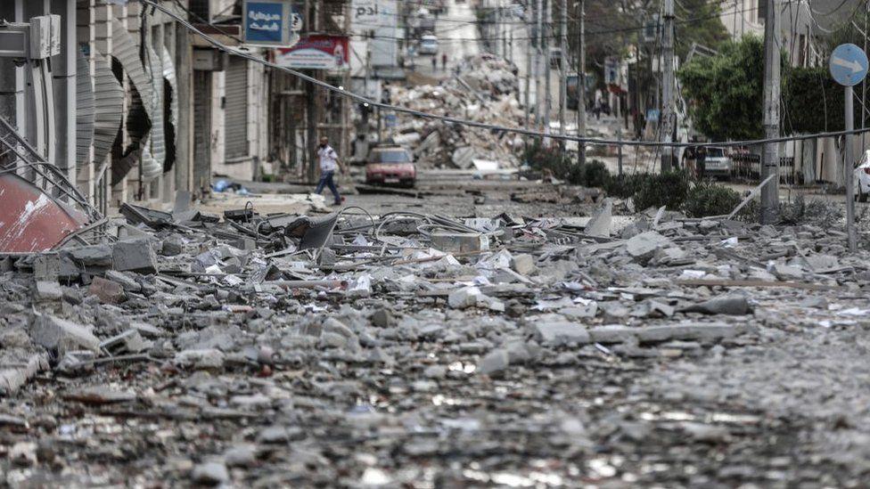 Damaged street is seen after Israeli warplanes strike headquarters of the Qatari Red Crescent Society in al-Rimal neighborhood of Gaza City, Gaza on May 17, 2021