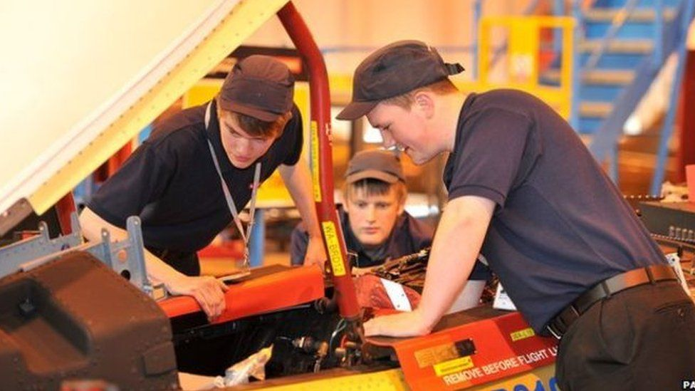 apprentices with motor car