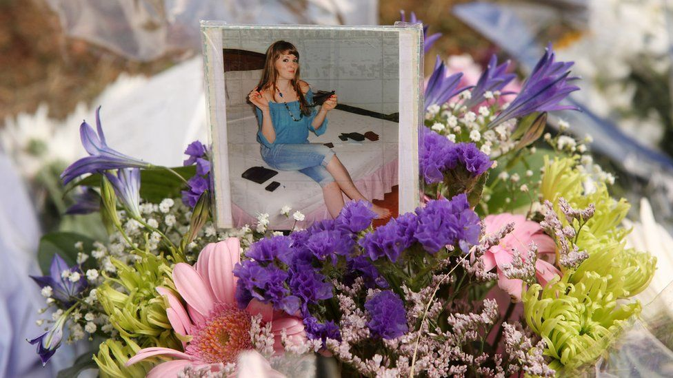 Flowers and a photograph of Catherine Hickman lay adjacent to a tower block on the Sceaux Gardens Estate in Camberwell following a fire on July 6, 2009 in London, England.