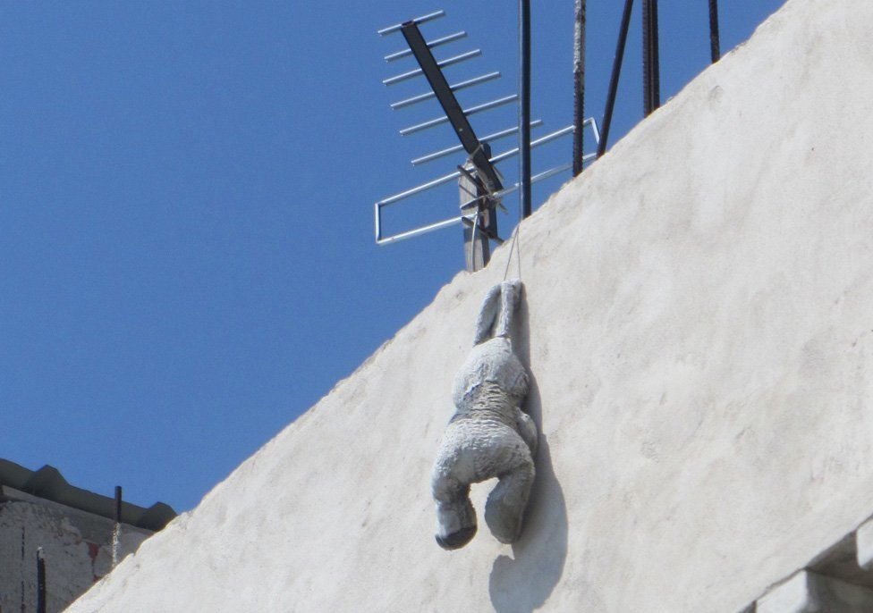 Rabbit hanging from aerial