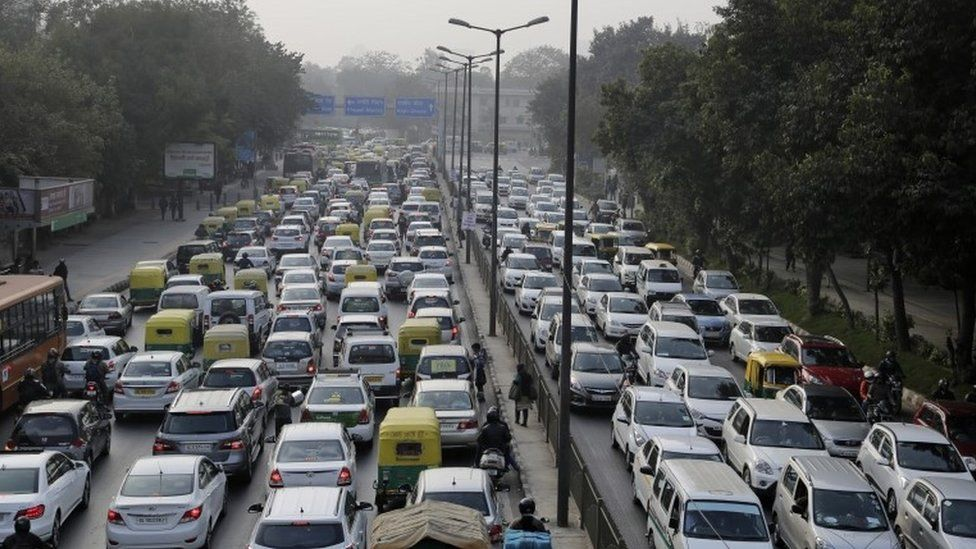 Vehicles move slowly at a traffic intersection after the end of a two-week experiment to reduce the number of cars to fight pollution in in New Delhi, India, Saturday, Jan. 16, 2016.