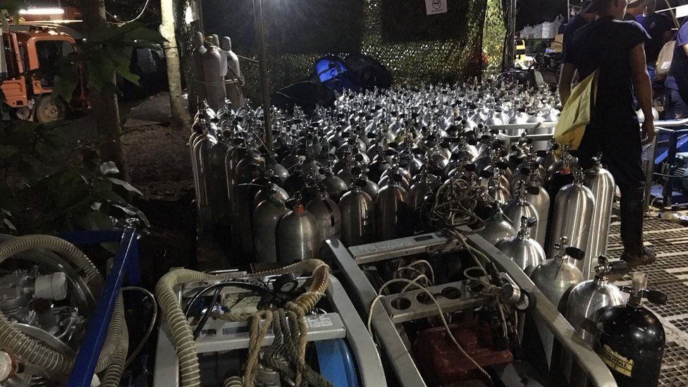 Oxygen tanks prepared for divers outside the cave complex