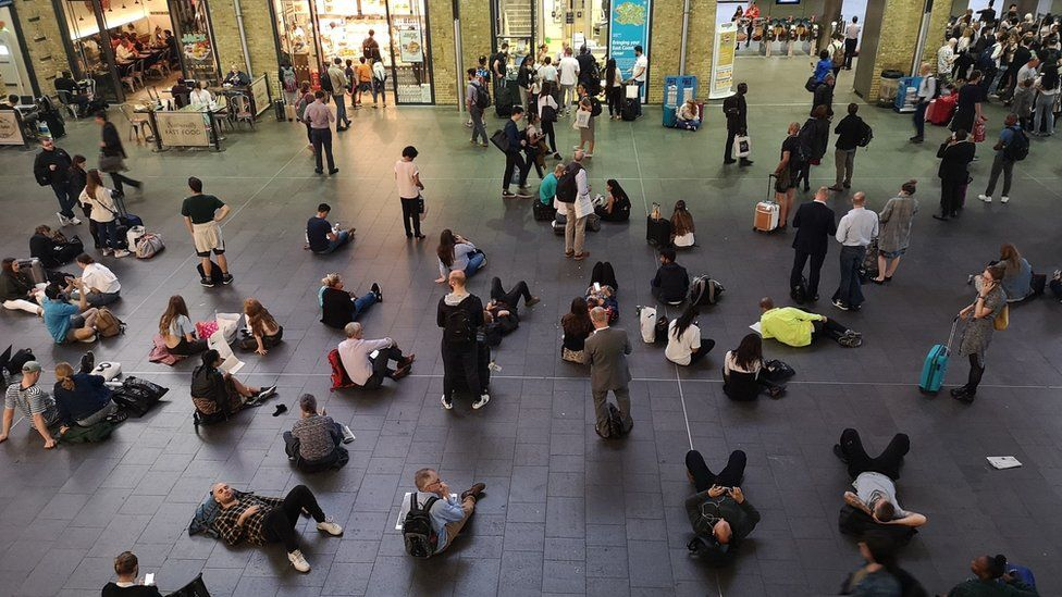People waiting inside Kings Cross station, London, as all services in and out of the station were suspended, after a large power cut