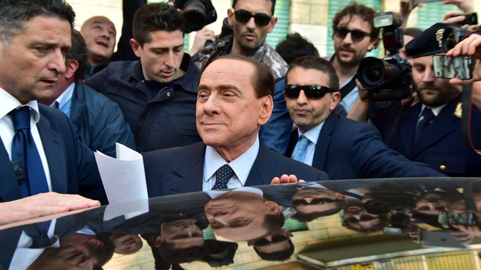 Berlusconi leaves Milan judicial offices in April 2014