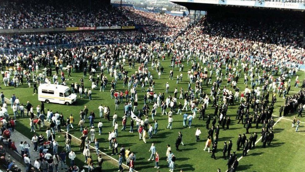 general view of fans on the pitch
