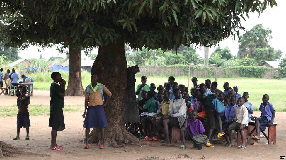 Schoolchildren attend class under a tree in Yei, South Sudan - 2012