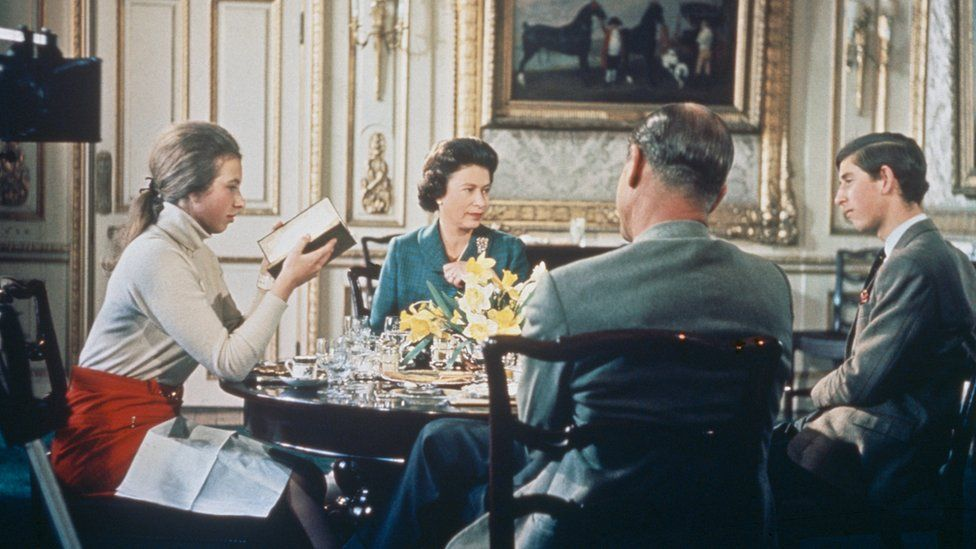 The Queen filmed having lunch withthe Duke of Edinburgh and their children Princess Anne and Prince Charles at Windsor Castle in around 1969