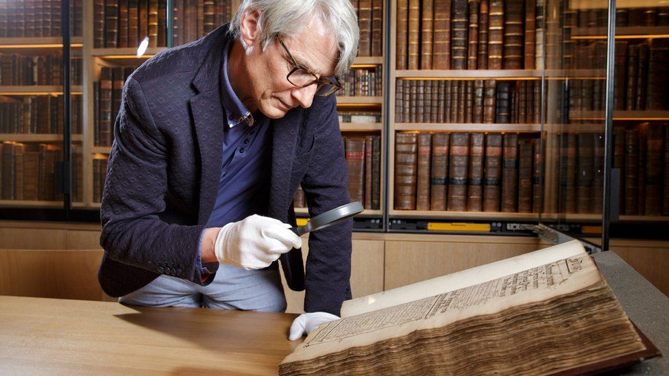 Geoffrey Marsh looking at archived records