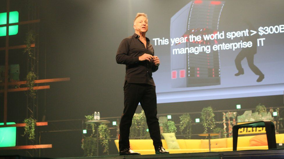 Michael Baum on stage at a tech event